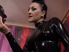 Female in latex strapon femdom